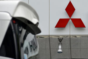 The logo of Mitsubishi Motors is displayed in front of the company's head office in Tokyo, Japan, 22 June 2016. The Japanese government said Tuesday that Mitsubishi Motors Corp. overstated mileage on its vehicles by up to 16 percent, but stopped short of slapping further penalties on the company. (Photo by Hitoshi Yamada/NurPhoto via Getty Images)