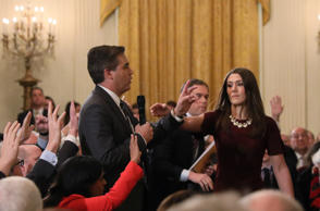 A White House intern reaches for and tries to take away the microphone held by CNN correspondent Jim Acosta as he questions U.S. President Donald Trump during a news conference at the White House in Washington, U.S., November 7, 2018. Picture taken November 7, 2018. REUTERS/Jonathan Ernst (Picture 3 in a sequence of 15)