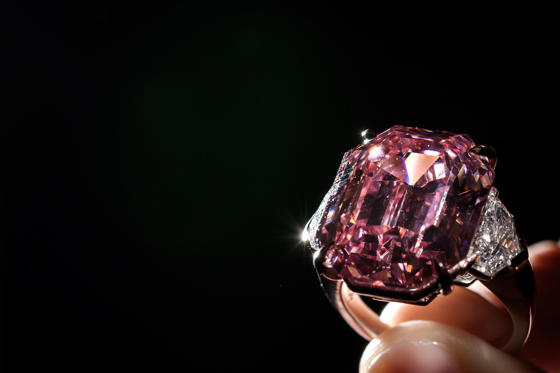 Slide 1 of 16: The Pink Legacy, a 18.96 carat fancy vivid pink diamond once owned by Oppenheimer family is displayed on November 8, 2018 during a press preview ahead of sales by Christie's auction house in Geneva. - The auction will take place in Geneva on November 13, 2018. (Photo by Fabrice COFFRINI / AFP)        (Photo credit should read FABRICE COFFRINI/AFP/Getty Images)