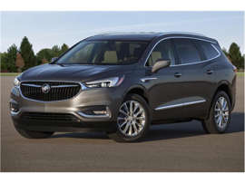 a car parked in a parking lot: 2018 Buick Enclave