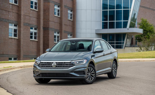 a car parked on the side of a building: 2019 Volkswagen Jetta SEL