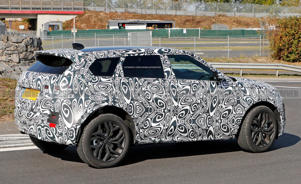 a car parked on the side of a road: 2020 Range Rover Evoque Spied Looking like a Baby Velar