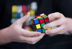 A youth scrambles a Rubik's Cube in Duesseldorf, Germany, 19 November 2013. At the weekend the German Speedcubing Championship takes place. About 100 participants will compete in different disciplines on Saturday and Sunday. The German record lays below seven secodns. Photo: BERND THISSEN/dpa | usage worldwide   (Photo by Bernd Thissen/picture alliance via Getty Images)