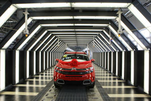 A Citroen C5 Aircross SUV rolls off the assembly line in Chengdu in China's southwestern Sichuan province on August 22, 2017.  The red SUV was the 50,000th motor vehicle produced by Shenlong factory in Chengdu for Citroen Auto. / AFP PHOTO / STR / China OUT        (Photo credit should read STR/AFP/Getty Images)