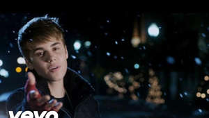 a man that is standing in the dark: 'Under The Mistletoe' now on vinyl: http://smarturl.it/UnderMistletoeLP Listen to more holiday favorites by Justin Bieber here: http://smarturl.it/ChristmasPlaylist-JB   Music video by Justin Bieber performing Mistletoe. (C) 2011 The Island Def Jam Music Group Buy on iTunes - http://idj.to/qQNYau #VEVOCertified on March 2, 2012. http://www.youtube.com/vevocertified
