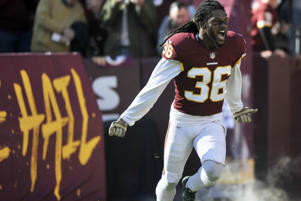 Washington Redskins free safety D.J. Swearinger runs onto the field prior to an NFL football game against the Atlanta Falcons, Sunday, Nov. 4, 2018, in Landover, Md. (AP Photo/Mark Tenally)