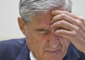 In a photo from Wednesday, May 9, 2012, then-FBI Director Robert Mueller appears before the House Judiciary Committee on Capitol Hill in Washington. (AP Photo/J. Scott Applewhite)