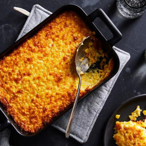 a slice of pizza sitting on top of a pan on a table: A Creamy, Cheesy Casserole That Treats Fresh Corn Right