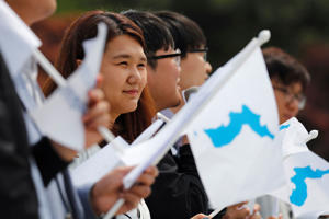 Students hold Korean Unification Flags during a pro-unification rally ahead of the upcoming summit between North and South Korea in Seoul, South Korea.