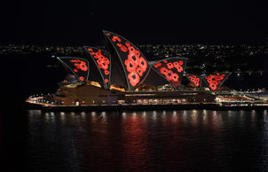 SYDNEY, AUSTRALIA - NOVEMBER 11:  Poppies are projected onto the sails of the Opera House on November 11, 2018 in Sydney, Australia. Remembrance Day 2018 marks the centenary anniversary of the Armistice that ended the First World War on 11 November 1918. Almost 62,000 Australians died fighting in four years of global conflict. On this day Australians observe one minute's silence at 11 am to honour those who have served and those who have died in war and on peacekeeping and humanitarian operations.  (Photo by James D. Morgan/Getty Images)