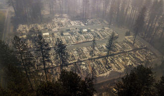 Residences leveled by the wildfire line a neighborhood in Paradise, Calif., on Thursday, Nov. 15, 2018. The California Department of Forestry and Fire Protection said Thursday the wildfire that destroyed the town of Paradise is now 40 percent contained, up from 30 percent Wednesday morning.  (AP Photo/Noah Berger)