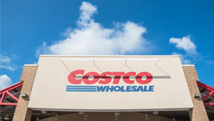a close up of a sign: Why Costco Is Still Dominating the Retail Industry