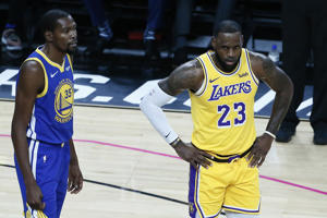 LAS VEGAS, NV- OCTOBER 10: LeBron James #23 of the Los Angeles Lakers and Kevin Durant #35 of the Golden State Warriors look on during the game on October 10, 2018 at T-Mobile Arena in Las Vegas, Nevada.