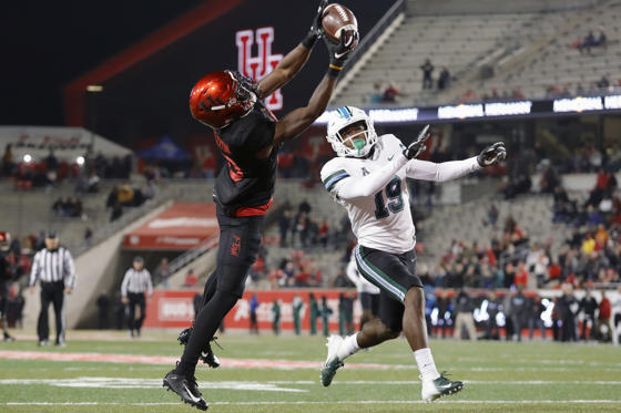 Slide 1 of 75: HOUSTON, TX - NOVEMBER 15:  Jeremy Singleton #10 of the Houston Cougars catches a pass for a touchdown in the third quarter defended by Taris Shenall #19 of the Tulane Green Wave at TDECU Stadium on November 15, 2018 in Houston, Texas.  (Photo by Tim Warner/Getty Images)