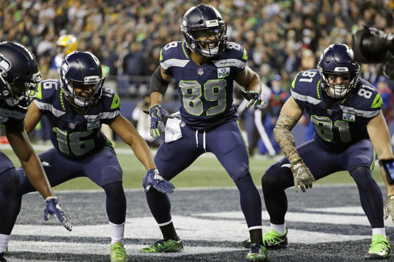 Slide 2 of 75: Seattle Seahawks wide receiver Doug Baldwin (89) takes part in a touchdown celebration with Tyler Lockett, left, and Nick Vannett, right, after Baldwin caught a pass for a touchdown against the Green Bay Packers during the first half of an NFL football game, Thursday, Nov. 15, 2018, in Seattle. (AP Photo/Elaine Thompson)
