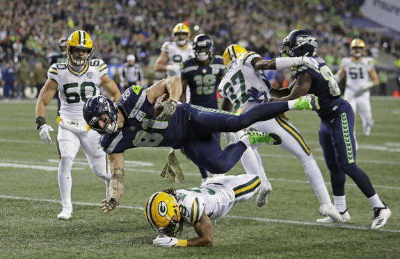 Slide 3 of 75: Seattle Seahawks tight end Nick Vannett (81) gets horizontal above Green Bay Packers cornerback Tramon Williams, lower-center, as Vannett carries the ball just short of the goal line against the Green Bay Packers during the first half of an NFL football game, Thursday, Nov. 15, 2018, in Seattle. (AP Photo/Stephen Brashear)