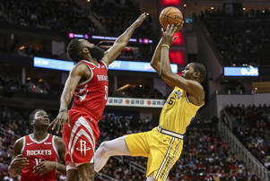 Nov 15, 2018; Houston, TX, USA; Golden State Warriors forward Kevin Durant (35) shoots the ball as Houston Rockets guard James Harden (13) defends during the third quarter at Toyota Center.