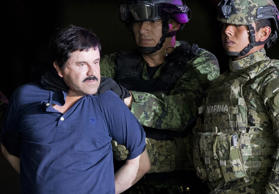 "FILE - In this Jan. 8, 2016 file photo, a handcuffed Joaquin ""El Chapo"" Guzman is made to face the press as he is escorted to a helicopter by Mexican soldiers and marines at a federal hangar in Mexico City. A federal judge says he won't dismiss the New York drug trafficking case against Mexican drug lord Joaquin ""El Chapo"" Guzman. Judge Brian Cogan ruled Friday, Sept. 15, 2017 that El Chapo can't raise the issue without protest or objection from Mexico. (AP Photo/Eduardo Verdugo, File)"