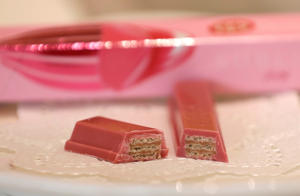 NestleÕs KITKAT Chocolatory Sublime Ruby, made of pink 'Ruby' chocolate, on a plate is pictured with its package during a photo opportunity at KITKAT Chocolatory shop in Tokyo, Japan January 25, 2018. REUTERS/Kim Kyung-Hoon