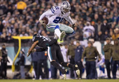 Nov 11, 2018; Philadelphia, PA, USA; Dallas Cowboys running back Ezekiel Elliott (21) leaps over the tackle attempt of Philadelphia Eagles defensive back Tre Sullivan (37) during the second quarter at Lincoln Financial Field. Mandatory Credit: Bill Streicher-USA TODAY Sports     TPX IMAGES OF THE DAY