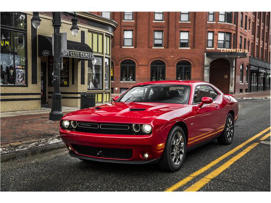 a red car parked on a city street: 2018 Dodge Challenger