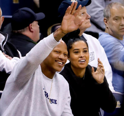 Slide 1 of 80: The Steelers linebacker Ryan Shazier, waves to fans as he sits with his wife, Michelle Shazier, as they watch the second half of an NCAA college basketball game between Pittsburgh and Central Arkansas, on Nov. 15, in Pittsburgh.