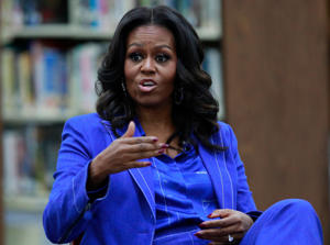 Former US first lady Michelle Obama attends a roundtable discussion at Whitney M. Young Magnet High School in Chicago, November 12, 2018. - Former US first lady Michelle Obama's book, 'Becoming,' hits stores on Tuesday. Obama, 54, will head out on a multi-city arena tour to promote the memoir, with celebrity friends like Oprah Winfrey and Reese Witherspoon tapped to moderate the events. (Photo by JIM YOUNG / AFP)        (Photo credit should read JIM YOUNG/AFP/Getty Images)