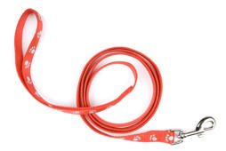 Red nylon dog lead or leash with paw print pattern isolated over white