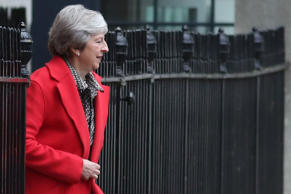 Britain's Prime Minister Theresa May leaves 10 Downing Street in central London on November 16, 2018. - British Prime Minister Theresa May battled on November 16 to salvage a draft Brexit deal and her own political future. After a tumultuous Thursday in which ministers resigned and members of her own party plotted to oust her, May  faced the public to defend her position, in a radio phone-in. (Photo by Daniel LEAL-OLIVAS / AFP)        (Photo credit should read DANIEL LEAL-OLIVAS/AFP/Getty Images)