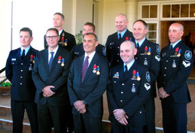 Clockwise from left; the team that helped in last week's Thailand cave rescue Matthew Fitzgerald, Troy Eather, Justin Bateman, Robert James, Christopher Markcrow, Kelly Boers, Benjamin Cox, Craig Challen and Richard Harris pose for photographs with their bravery medals outside Government House in Canberra, Australia, on Tuesday, July 24, 2018. The nine Australians involved in rescuing 12 boys and their 25-year-old soccer coach from a Thai cave were presented with medals for putting their lives in danger during the ordeal.