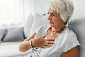 Female with chest pain. Senior woman suffering from heartburn or chest discomfort symptoms. Acid reflux or Gastroesophageal reflux disease (GERD) concept