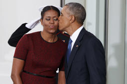 President Barack Obama kisses first lady Michelle Obama as they wait for President-elect Donald Trump and his wife Melania Trump at the White House, Friday, Jan. 20, 2017, in Washington. (AP Photo/Evan Vucci)