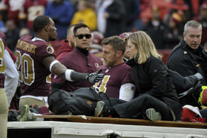 Washington Redskins free safety Ha Ha Clinton-Dix (20) consoles quarterback Alex Smith (11) after Smith's leg injury during an NFL football game against the Houston Texans, Sunday, Nov. 18, 2018, in Landover, Md. (AP Photo/Mark Tenally)