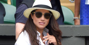 "a person wearing a hat: Meghan Markle has been told to dress less like a ""Hollywood star"" and more like a royal thanks to the Queen raising her eyebrows at the Duchess' personal style."