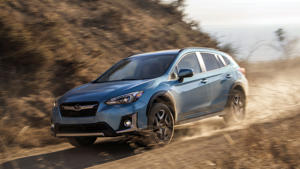 a car parked on the side of the road: 2019 Subaru Crosstrek Hybrid