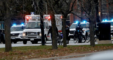 An ambulance believed to be carrying an injured Chicago police officer departs Mercy Hospital on Monday, Nov. 19, 2018. Multiple people were reported shot on the Near South Side. (Zbigniew Bzdak/Chicago Tribune/TNS via Getty Images)