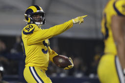 Los Angeles Rams outside linebacker Samson Ebukam reacts after he scored a touchdown after recovering a fumble against the Kansas City Chiefs during the first half of an NFL football game, Monday, Nov. 19, 2018, in Los Angeles. (AP Photo/Marcio Jose Sanchez)