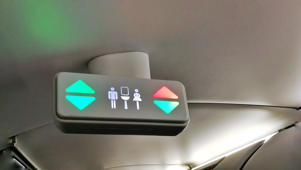 A lavatory sign on plane