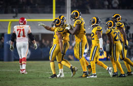 Los Angeles Rams cornerback Marcus Peters, points towards Kansas City Chiefs bench after making an interception during an NFL football game Monday, Nov. 19, 2018, in Los Angeles. (AP Photo/Kyusung Gong)