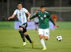 Soccer Football - International Friendly - Argentina v Mexico - Estadio Mario Alberto Kempes, Cordoba, Argentina - November 16, 2018  Mexico's Angel Zaldivar in action with Argentina's Ramiro Funes Mori   REUTERS/Gustavo Garello