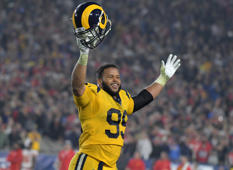 Nov 19, 2018; Los Angeles, CA, USA; Los Angeles Rams defensive end Aaron Donald (99) celebrates in the fourth quarter against the Kansas City Chiefs at the Los Angeles Memorial Coliseum. Mandatory Credit: Kirby Lee-USA TODAY Sports - 11701270