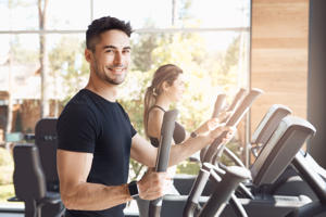 Young man and woman exercise together cardio workout