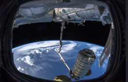 In this image provided by NASA, a commercial shipment arrives at the International Space Station on Monday, Nov. 19, 2018. Astronaut Serena Aunon-Chancellor used the space station's robot arm to grab Northrop Grumman's capsule. It's named after Apollo 16 moonwalker and the first space shuttle commander John Young, who died in January. (Alexander Gerst/European Space Agency, NASA via AP)