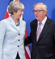 EU Commission handout picture showing EU President Jean-Claude Juncker standing with British Prime Minister Theresa May at the EU Commission in Brussels.