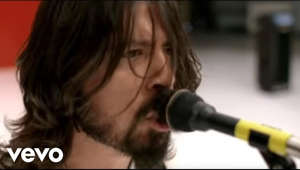 Foo Fighters' official music video for 'The Pretender'. Click to listen to Foo Fighters on Spotify: http://smarturl.it/FooFSpotify?IQid=F...  As featured on Greatest Hits. Click to buy the track or album via iTunes: http://smarturl.it/FFGHiTunes?IQid=Fo... Google Play: http://smarturl.it/FFPretplay?IQid=Fo... Amazon: http://smarturl.it/FFGHAmz?IQid=FooFTP  More from Foo Fighters My Hero: https://youtu.be/EqWRaAF6_WY Everlong: https://youtu.be/eBG7P-K-r1Y Learn to Fly: https://youtu.be/1VQ_3sBZEm0  Follow Foo Fighters Website: http://foofighters.com/ Facebook: https://www.facebook.com/foofighters Twitter: https://twitter.com/foofighters Instagram: https://instagram.com/foofighters/  Subscribe to Foo Fighters on YouTube: http://smarturl.it/FooFSub?IQid=FooFTP  More great Alternative 00s videos here: http://smarturl.it/Alternative00?IQid...  ---------  Lyrics:  Keep you in the dark You know they all pretend Keep you in the dark And so it all began  Send in your skeletons Sing as their bones go marching in... again The need you buried deep The secrets that you keep are ever ready Are you ready? I'm finished making sense Done pleading ignorance That whole defense""