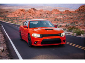 a red car parked on the side of a road: 2018 Dodge Charger