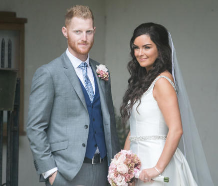 Slide 2 of 20: England all-rounder Ben Stokes and his newly married wife Clare, outside St Mary the Virgin, East Brent, Somerset. (Photo by Steve Parsons/PA Images via Getty Images)