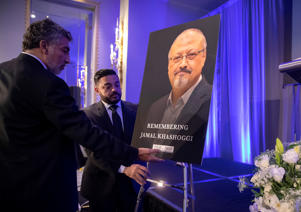 Mongi Dhaouadi, left, and Ahmed Bedier set up an image of slain Saudi journalist Jamal Khashoggi before an event to remember Khashoggi, a columnist for The Washington Post who was killed inside the Saudi Consulate in Istanbul on Oct. 2, in Washington, Friday, Nov. 2, 2018. (AP Photo/J. Scott Applewhite)