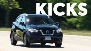 a person driving a car: 2018 Nissan Kicks Road Test