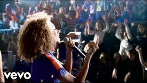 a person standing in front of a crowd: Vote for your favourite girl group here: https://www.udiscovermusic.com/stories/best-girl-groups/ Listen to more from the Spice Girls: http://spicegirls.lnk.to/Essentials  Listen to some of the Spice Girls' biggest hits here: http://playlists.udiscovermusic.com/playlist/spice-girls-best-of  Follow the Spice Girls https://twitter.com/OfficialMelB/ https://twitter.com/MelanieCmusic https://twitter.com/EmmaBunton https://twitter.com/victoriabeckham https://twitter.com/gerihalliwell  https://www.thespicegirls.com/  Music video by Spice Girls performing Mama.